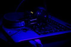 Keyboard and headphones in ultra-violet rays Royalty Free Stock Images