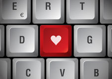 Keyboard with heart. White keyboard, red touch with heart Stock Image