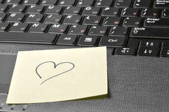 Keyboard with heart on sticky note Stock Photos