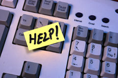 Keyboard help. Help word on a post-it, on a keyboard Stock Image