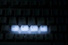 Keyboard Help. Darkly lit keyboard with help keys illuminated Royalty Free Stock Image