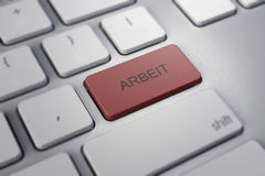 Keyboard and key Arbeit on it. Royalty Free Stock Photography