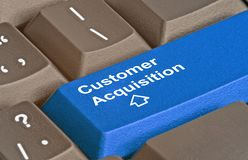 Key for customer acquisition. Keyboard with key for customer acquisition stock photos