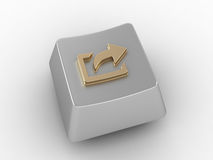 Keyboard key with gold arrow sign. Stock Image