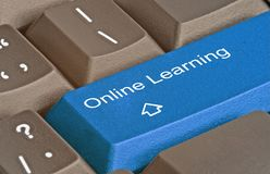 Key for online learning. Keyboard with key for online learning Stock Photo