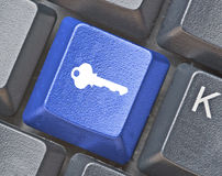Keyboard with key for security Stock Photo
