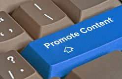 Key to promote content. Keyboard with key to promote content Royalty Free Stock Photo