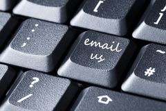 Keyboard keys. Close up of black computer keyboard with email us sign on a button Royalty Free Stock Photography