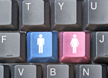 Keyboard with  keys for man and woman Stock Photos
