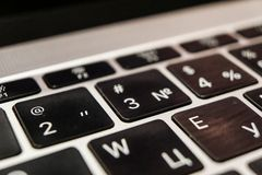 Keyboard of laptop by Apple, russian version. Keyboard of laptop by Apple, with russian letters and buttons stock images