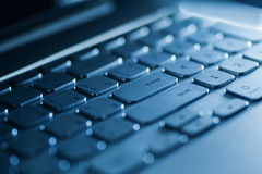Keyboard on a laptop in blue color Stock Image