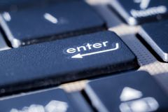 on the keyboard of the laptop - a close-up key to enter, a symbol for entering and storing information_ stock images