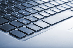 Keyboard from laptop with cyanotype saturation Royalty Free Stock Photo
