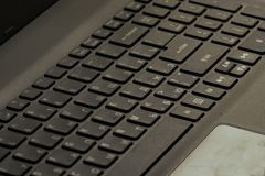 Laptop keyboard,. The keyboard of the laptop with Russian-English letters of gray color is located on a diagonal of a frame royalty free stock photos