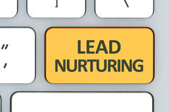 Keyboard with lead nurturing button. Computer white keyboard wit Stock Photography