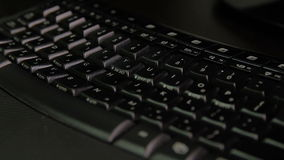 Keyboard with letters in Hebrew and English. Wireless keyboard - Right side View - Close up - Changing Focus stock video footage