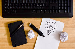 Keyboard and light bulb drawing royalty free stock photo