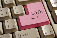 Keyboard of love. The pink key could be found only on the love keyboard stock photo