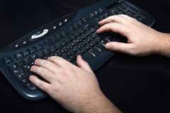 Keyboard. Man's hands on the keyboard stock images