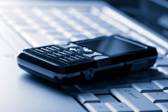 Keyboard and mobile phone background Stock Image