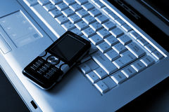 Keyboard and mobile phone background Stock Images