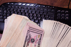 Keyboard and money, a place for records Stock Photo
