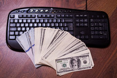 Keyboard and money, a place for records, business. Plan, money background, hundred dollar bills front side. background of dollars, new hundred-dollar bil face Stock Photos