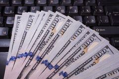Keyboard and money Royalty Free Stock Photography