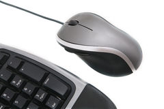 Keyboard and Mouse. Isolated ergonomic keyboard and mouse shot over white background Royalty Free Stock Photo