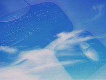 Keyboard and mouse. Over sky . You can find different versions of this image in my gallery !Hope you like it royalty free illustration