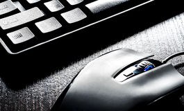 Keyboard and mouse on black background Royalty Free Stock Image