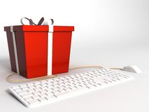 Keyboard ,mouse and wrapped red gift Royalty Free Stock Photo