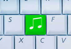 Keyboard with music key Stock Image