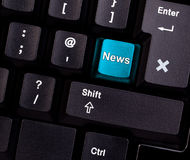 Keyboard news. Keyboard with blue button, spelling news Royalty Free Stock Photos
