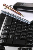 Keyboard and note book Stock Image