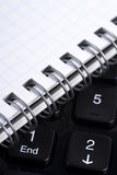 Keyboard and notebook. Black keyboard and notebook close up Royalty Free Stock Photography