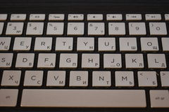 Keyboard for notebook. Beautiful keys with neon violet light under letters Royalty Free Stock Photo