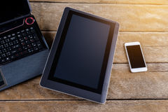 Keyboard of Notebook with smartphone and tablet pc on desk Royalty Free Stock Photography