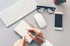 Keyboard, notepad, phone, hands stock photo