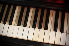 Keyboard of an old piano. Royalty Free Stock Photography