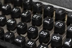 Keyboard of an old Soviet typewriter for spies with Russian and English letters, close-up. Keyboard of old Soviet typewriter for spies with Russian and English stock photo