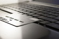 Keyboard. Open black laptop and credit card on keyboard stock photo