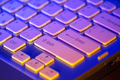 Keyboard of an open laptop. Closeup. Keyboard modern laptop photographed with the effect of colored illumination stock photography