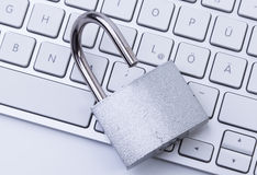 Keyboard and open padlock Royalty Free Stock Photo