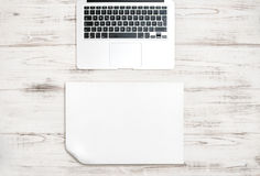 Keyboard over wooden desk. Paper background. Office  workspace Stock Photography