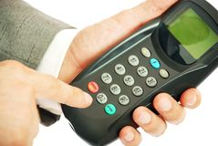 The keyboard panel in a hand. The person confirms payment on atm Stock Image