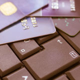 Keyboard and payment cards. Computer keyboard with credit card background Stock Images