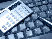 Keyboard, pen and calculator (blue) Stock Photos