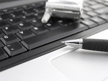 Keyboard, pen and mobile phone Royalty Free Stock Images