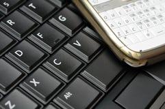 Keyboard and phone Stock Photos